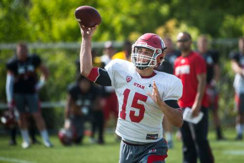 Chris Detrick     The Salt Lake Tribune Utah Utes quarterback Chase Hansen (15) throws the ball during a practice Tuesday April 21, 2015.
