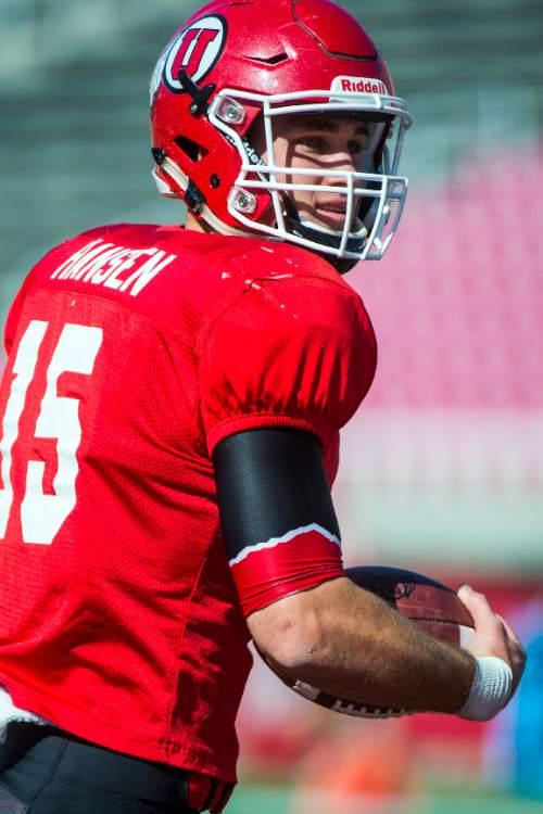 Chris Detrick     The Salt Lake Tribune Utah Utes quarterback Chase Hansen (15) during a practice at Rice-Eccles Stadium Friday April 3, 2015.