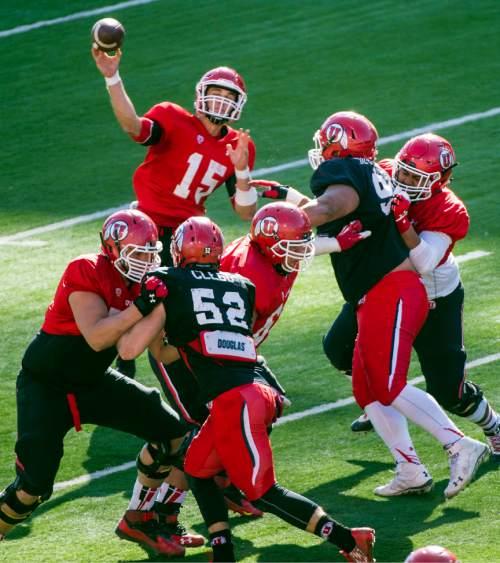 Chris Detrick     The Salt Lake Tribune Utah Utes quarterback Chase Hansen (15) passes the ball during a practice at Rice-Eccles Stadium Friday April 3, 2015.
