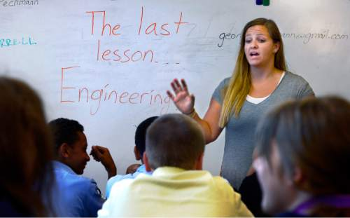 Scott Sommerdorf   |  The Salt Lake Tribune Alianza Academy teacher Aimee Devine teaches 7th and 8th graders at the school, Thursday, August 20, 2015. It will permanently close its doors after Friday due to its charter being revoked by the State Charter School Board.