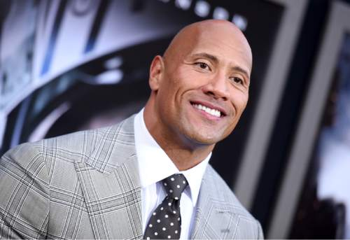 "Dwayne Johnson arrives at the premiere of ""San Andreas"" at the TCL Chinese Theatre on Tuesday, May 26, 2015, in Los Angeles. (Photo by Richard Shotwell/Invision/AP)"
