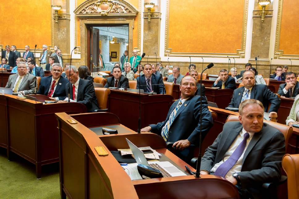 Trent Nelson  |  The Salt Lake Tribune Legislators look as the Utah House votes to approve the Prison Relocation Commission's recommendation to build a new correctional facility in Salt Lake City, Wednesday August 19, 2015.