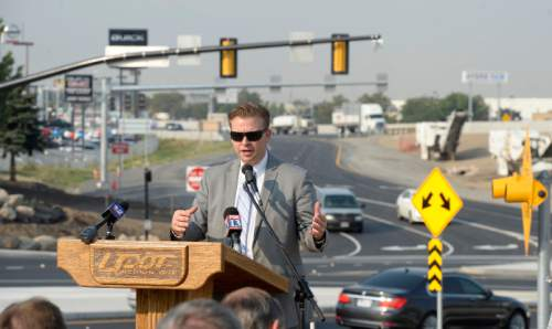 Al Hartmann     The Salt Lake Tribune State Sen. Todd Weiler, R-Woods Cross, speaks at event to celebrate completion of an I-15 South Davis Improvement Project major milestone, the diverging diamond interchange at 2600 South and I-15 in Woods Cross. He plans on using the interchange to get home. Officials commemorated the event with a tree planting on the edge of the interchange Friday August 21.