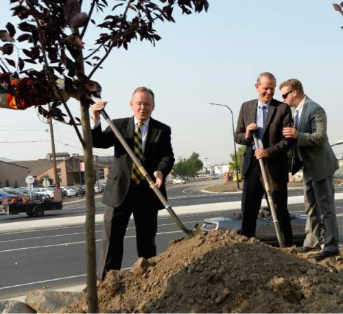 Al Hartmann     The Salt Lake Tribune State Sen. Stuart Adams, left, Rep. Brad Dee, and Sen. Todd Weiler grab shovels to plant trees to commemorate completion of an I-15 South Davis Improvement Project major milestone, the diverging diamond interchange at 2600 South and I-15 in Woods Cross, Friday August 21.
