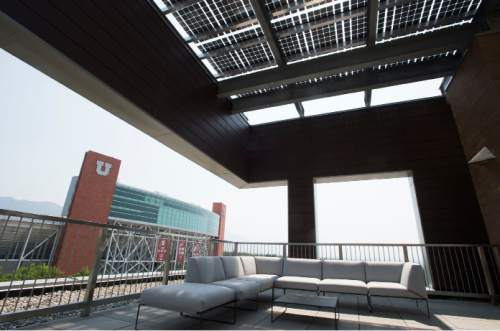 Steve Griffin  |  The Salt Lake Tribune  The University of Utah will celebrate the grand opening of its new $62.5 million College of Law building next week. View of Rice-Eccles Stadium from the rooftop garden in the building on the campus of he University of Utah in Salt Lake City, Friday, August 21, 2015.  Solar panels run the length of the building, top, on the south side.
