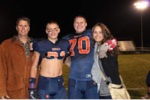 |  Courtesy Mikki Kane-Barton  The Barton family (from left, Paul, Cody, Jackson and Mikki Kane-Barton) pose together on Jackson's senior night in 2013 at Brighton High. Both Paul and Mikki were athletes at Utah before their sons elected to follow in their footsteps by joining the Utes football team.