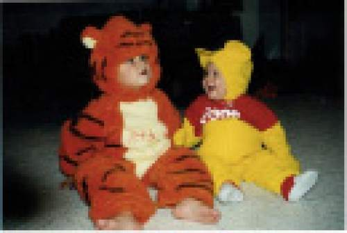 |  Courtesy Mikki Kane-Barton  Jackson, left, and Cody Barton celebrate Halloween for the first time together in 1997 with a Winnie the Pooh theme. Both would grow up to play for the Utah Utes football program.
