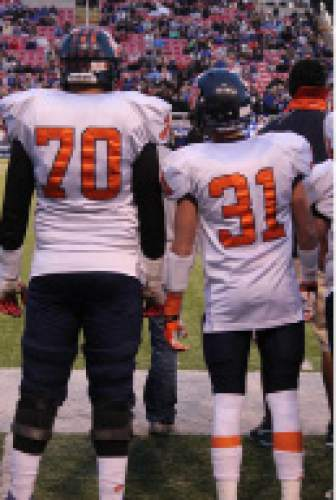 |  Courtesy Mikki Kane-Barton  Jackson Barton, No. 70, and Cody Barton stand side by side during Brighton's game against Bingham in the 2013 5A championship. Brighton lost the game, but it was one of the few games the brothers were able to play in together that season.