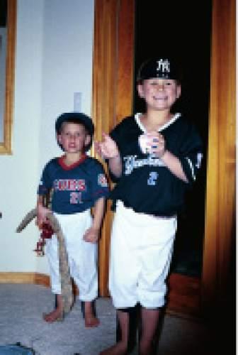 |  Courtesy Mikki Kane-Barton  Cody, left, and Jackson Barton pose in their baseball uniforms as children. Their father and former Ute baseball player Paul Barton coached their little league teams.