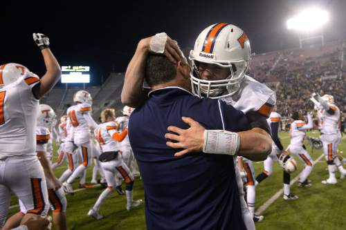 Chris Detrick  |  The Salt Lake Tribune Timpview's Britain Covey (2) hugs head coach Cary Whittingham after winning the 4A state championship game at Rice-Eccles Stadium Friday November 21, 2014.