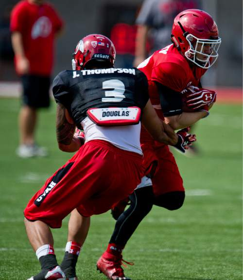 Lennie Mahler  |  The Salt Lake Tribune  Wide receiver Britain Covey gains some extra yards on a pass during Utah football fall camp at Rice-Eccles Stadium in Salt Lake City.  Saturday, Aug. 8, 2015.