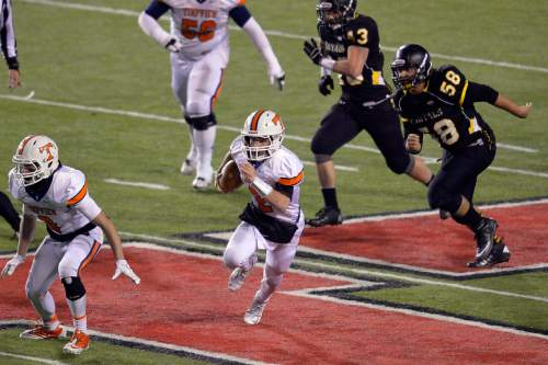 Chris Detrick  |  The Salt Lake Tribune Timpview's Britain Covey (2) runs the ball past Roy defense during the 4A state championship game at Rice-Eccles Stadium Friday November 21, 2014.