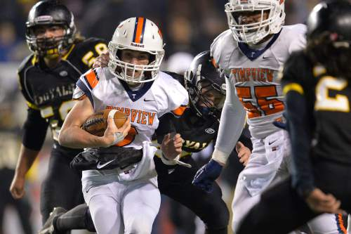 Chris Detrick  |  The Salt Lake Tribune Timpview's Britain Covey (2) is tackled by Roy's Brandon Storey (44) during the 4A state championship game at Rice-Eccles Stadium Friday November 21, 2014.