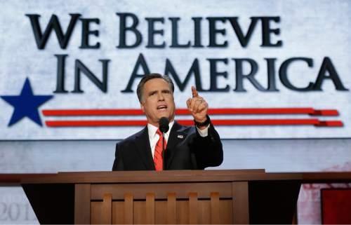 """FILE - In this Aug. 30, 2012, file photo Republican presidential nominee Mitt Romney addresses delegates at the Republican National Convention in Tampa, Fla. A deep obsession with the story of America, who tells it, and who gets to write its next chapter , was a rare piece of common ground that speakers at both the Republican and Democratic conventions managed to share. Over and over, they spun different versions of the same notion. Romney spoke passionately of """"the essence of the American experience."""" (AP Photo/Charles Dharapak, File)"""