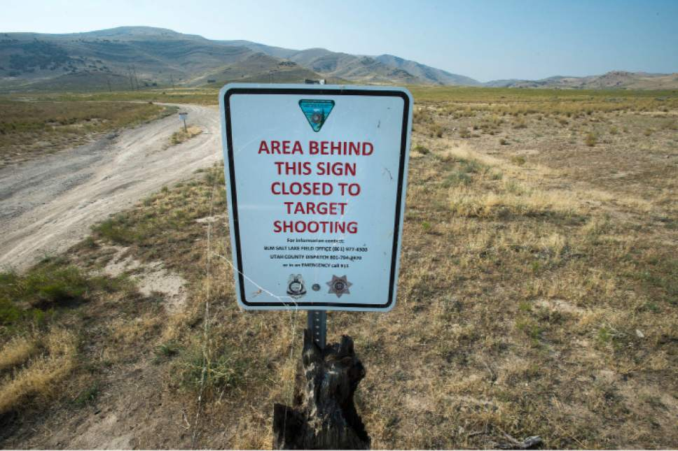 Steve Griffin  |  The Salt Lake Tribune  Target shooters are impacting public land on the Lake View Mountains west of Utah Lake. BLM is now devising a new management plan and proposes giving land to the county to manage as a public shooting range. Here a sign marks an area closed to shooting south of Saratoga Springs, Utah Wednesday, August 19, 2015.  l