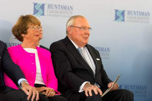 Trent Nelson  |  Tribune file photo A scamster is using Jon Huntsman Sr.'s name in a scheme to obtain people's banking account information by promising to give them millions of dollars from the Huntsman fortune. The fraud has troubled the philanthrophist and the cancer center that bears his name. In this file photo, Karen and Jon Huntsman Sr. listen to speakers as the Huntsman Cancer Institute breaks ground on a new wing, the Primary Children's & Families Cancer Research Center, in Salt Lake City, Friday June 6, 2014.