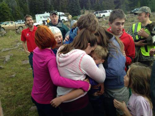 Courtesy  |  KUTV 2 News  Family members embrace 10-year-old Malachi Bradley, who had been missing since Sunday morning in eastern Utah's Ashley National Forest.