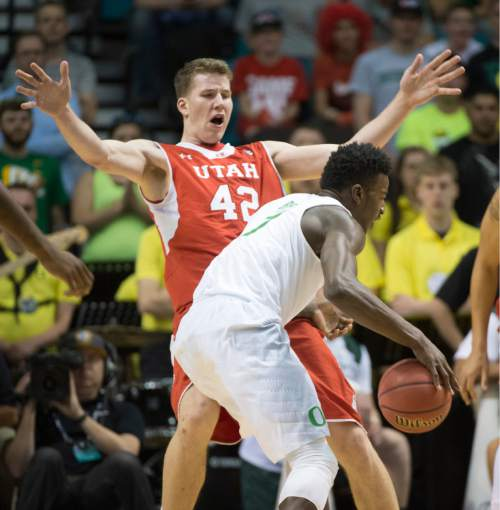 Rick Egan  |  The Salt Lake Tribune  Utah Utes forward Jakob Poeltl (42) draws a could as he Oregon Ducks forward Jordan Bell (1) collides with him, in Pac-12 Basketball Championship action Utah vs. Oregon, at the MGM Arena, in Las Vegas, Friday, March 13, 2015.
