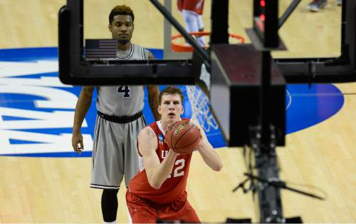 """Scott Sommerdorf      The Salt Lake Tribune Utah Utes forward Jakob Poeltl (42) at the could line as Georgetown Hoyas guard D'Vauntes Smith-Rivera (4) watches during first half play. Utah defeated Georgetown 75-64 to advance to the """"Sweet Sixteen"""", Saturday, March 21, 2015."""
