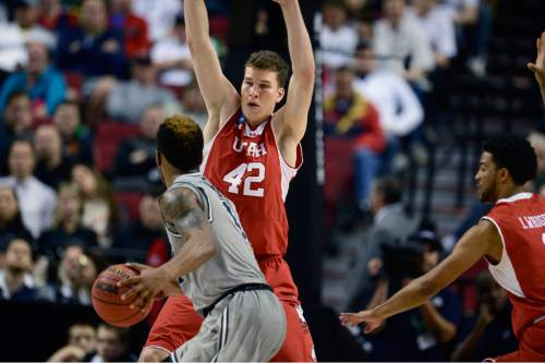 "Scott Sommerdorf   |  The Salt Lake Tribune Utah Utes forward Jakob Poeltl (42) defends against Georgetown Hoyas guard D'Vauntes Smith-Rivera (4) during second half play. Utah defeated Georgetown 75-64 to advance to the ""Sweet Sixteen"", Saturday, March 21, 2015."