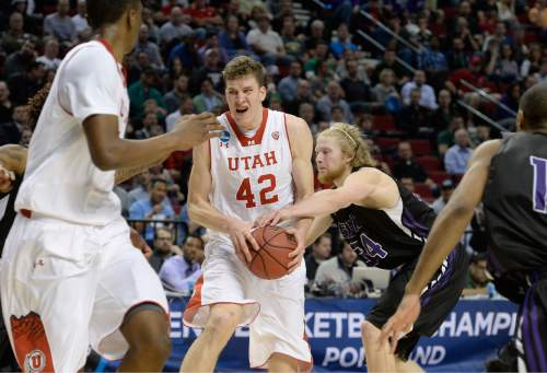 Scott Sommerdorf   |  The Salt Lake Tribune Utah forward Jakob Poeltl (42) played through some physical defense in the closing minutes as Utah defeated Stephen F. Austin 57-50 at the Moda Center in Portland,, Thursday, March 19, 2015.