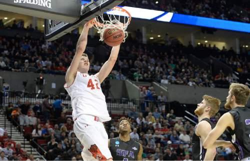 Scott Sommerdorf   |  The Salt Lake Tribune Utah forward Jakob Poeltl (42) dunks during second half play. Utah defeated Stephen F. Austin 57-50 at the Moda Center in Portland, Thursday, March 19, 2015.