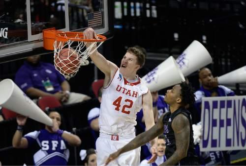 Scott Sommerdorf   |  The Salt Lake Tribune Utah forward Jakob Poeltl (42) dunks during first half play. Utah defeated Stephen F. Austin 57-50 at the Moda Center in Portland, Thursday, March 19, 2015.