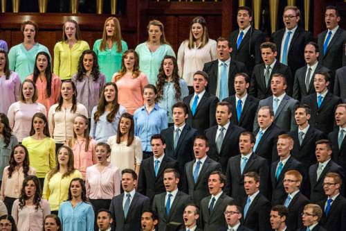 Chris Detrick  |  The Salt Lake Tribune Single men and women from Davis and Weber counties sing during the afternoon session of the 185th Annual LDS General Conference Saturday April 4, 2015.