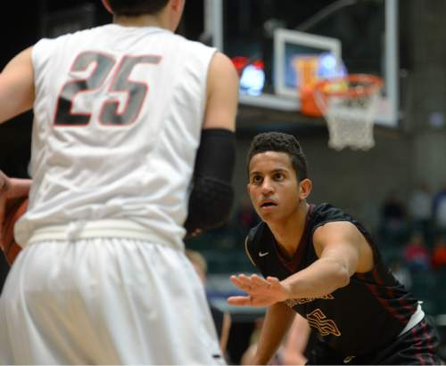 Steve Griffin  |  The Salt Lake Tribune  Lone Peak's Frank Jackson, knight, guards Amercian Fork's Brayden Harris during game between American Fork and Lone Peak at UVU UCCU Arena in Provo, Tuesday, February 10, 2015.