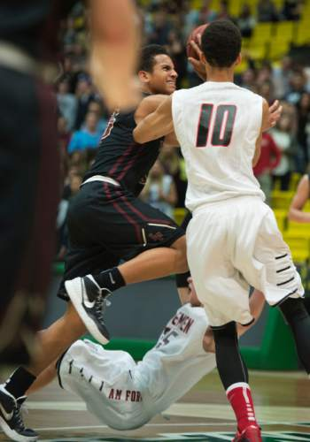Steve Griffin  |  The Salt Lake Tribune  Lone Peak's Frank Jackson crashes into the American Fork defense as he drives into the lane during game between American Fork and Lone Peak at UVU UCCU Arena in Provo, Tuesday, February 10, 2015.