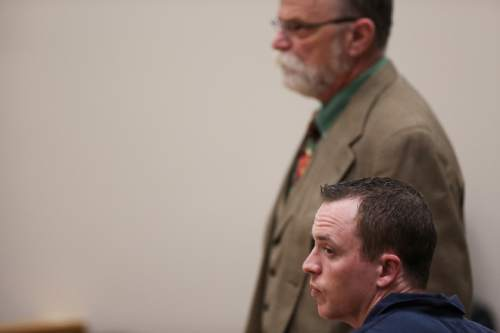 (Spenser Heaps  |  Pool) Conrad Truman, with his defense attorney Ron Yengich behind him, appears for sentencing at the 4th District Court in Provo on Monday, Feb. 9, 2015. Truman was sentenced to consecutive sentences of 15 years to life for murder and one to 15 years for obstruction of justice in the 2012 shooting death of his wife Heidy Truman.