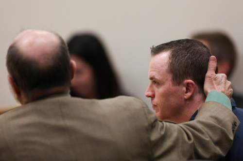 (Spenser Heaps  |  Pool) Defense attorney Ron Yengich rests his hand on the back of his client Conrad Truman's neck during Truman's sentencing at 4th District Court in Provo on Monday, Feb. 9, 2015. Truman was sentenced to consecutive sentences of 15 years to life for murder and one to 15 years for obstruction of justice in the 2012 shooting death of his wife Heidy Truman.