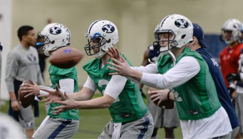Francisco Kjolseth  |  The Salt Lake Tribune  BYU football opens spring camp on Monday, March 2, 2015, as quarterbacks Hunter Moore, McCoy Hill and Taysom Hill, from left, work out in the Smith Fieldhouse.