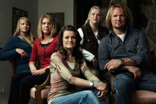 "Joe Pugliese  |  TLC  Kody Brown, right, with ""sister wives"" Christine, left, Meri, Robyn and Janelle. The Brown family says Utah's bigamy statute is unconstitutional and is suing the state."