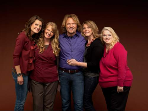 "File photo | The Associated Press  Kody Brown poses with wives Robyn, Christine, Meri and Janelle in a promotional photo for the reality series ""Sister Wives."""