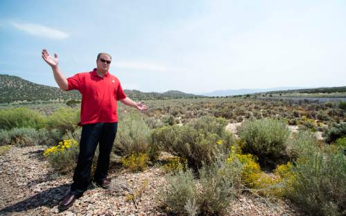 Rick Egan  |  The Salt Lake Tribune  Kelly Crane, district engineer, shows where a pipeline is planned in the Iron Springs area, near Cedar City, Friday, August 21, 2015