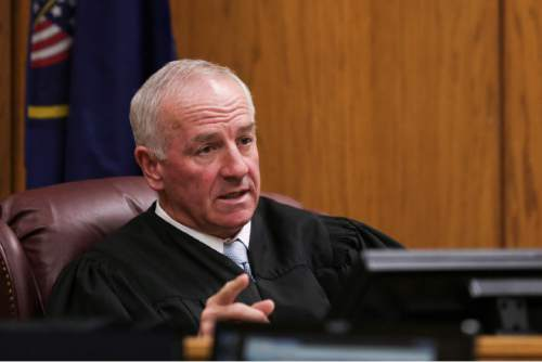 (Spenser Heaps  |  Pool) Judge Samuel McVey speaks during Conrad Truman's sentencing at 4th District Court in Provo on Monday, Feb. 9, 2015. Truman was sentenced to consecutive sentences of 15 years to life for murder and one to 15 years for obstruction of justice in the 2012 shooting death of his wife Heidy Truman.