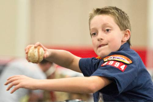 Rick Egan  |  The Salt Lake Tribune  Scott Sorensen,10, throws the baseball for speed, at the Utah Scouting Expo at the South Towne Expo Center, Saturday, May 2, 2015.