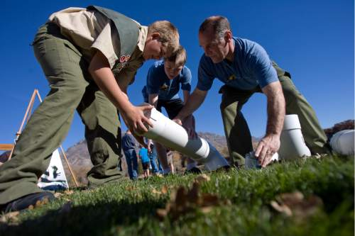 Tribune file photo John Petersen, Ammon Harris and Tony Harris build a container to recycle monofilament fishing line at the pond at Highland Glen Park in Highland, Utah on October 29, 2012. John Peterson decided to do outreach about the dangers of monofilament fishing line to wildlife as his Eagle Scout project and have been able to install these container at a few locations near fishing areas.