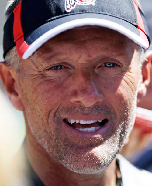 Utah coach Kyle Whittingham speaks with the media following an NCAA college football practice, Thursday, Aug. 13, 2015, in Salt Lake City. Whittingham has said the starting quarterback job is Travis Wilson's to lose. However, the competition remains open with Kendal Thompson. (AP Photo/Rick Bowmer)