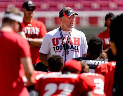 Trent Nelson  |  The Salt Lake Tribune University of Utah football coach Kyle Whittingham addresses the team after practice in Salt Lake City, Friday August 14, 2015.