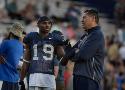 Scott Sommerdorf   |  The Salt Lake Tribune BYU WR Devon Blackmon talks with offensive coordinator Robert Anae as BYU football had it's first scrimmage, Friday, March 27, 2015.