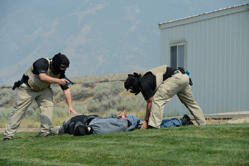 Francisco Kjolseth | The Salt Lake Tribune Adult Probation and Parole officers with the department of correction run through drills at the Fred House Academy at the point of the mountain next to the prison administration building. Though the prison is moving to Salt Lake City, there is no current plan to move these two buildings.