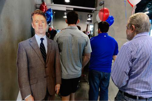 Scott Sommerdorf   |  The Salt Lake Tribune Visitors walk past a cardboard cutout of Rand Paul on their way to see the real thing. Republican Kentucky Senator Rand Paul visits Utah and speaks at a fundraising event at Alder Home Security in Orem, Saturday, August 29, 2015.