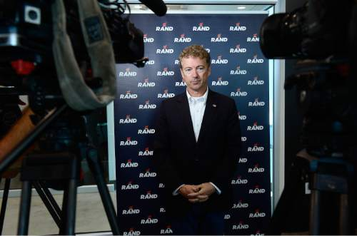 Scott Sommerdorf   |  The Salt Lake Tribune Republican Kentucky Senator Rand Paul waits for TV reporters to set up their mics prior to speaking at a press conference after he spoke at a fundraising event at Alder Home Security in Orem, Saturday, August 29, 2015.