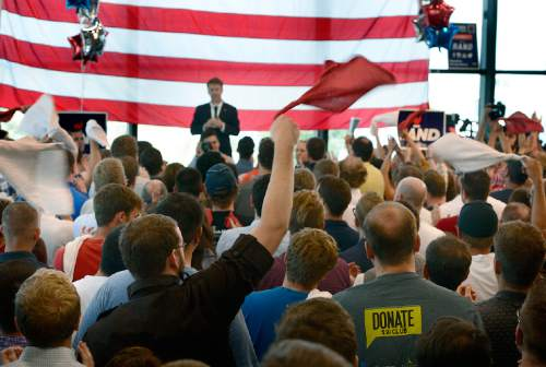 Scott Sommerdorf   |  The Salt Lake Tribune Supporters wave red and white hankies as they applause Republican Kentucky Senator Rand Paul as he visits Utah and speaks at a fundraising event at Alder Home Security in Orem, Saturday, August 29, 2015.