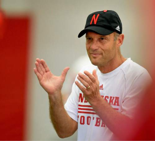 FILE - In this Aug. 6, 2015, file photo, Nebraska coach Mike Riley applauds during NCAA college football practice in Lincoln, Neb. Riley has a tough act to follow at Nebraska, replacing a coach who never won fewer than nine games over seven seasons. Despite the record, the Cornhuskers too often wilted in the most important games. It's Riley's task to restore the mojo of a program that hasn't won a conference title since 1999. (AP Photo/Nati Harnik, File)