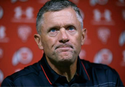 Utah NCAA college football coach Kyle Whittingham speaks during a news conference Monday, Aug. 31, 2015, in Salt Lake City. Jim Harbaugh and the Michigan Wolverines have been one of the biggest storylines headed into the 2015 college football season season, but Utah is the actual favorite in the season opener. The Utes have felt like an afterthought and are eager to prove otherwise. (AP Photo/Rick Bowmer)