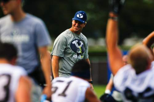 Head coach Bronco Mendenhall watches players stretch on the first day of fall football camp for Brigham Young University on Saturday, Aug. 8, 2015 in Provo, Utah. (Spenser Heaps/Daily Herald via AP)