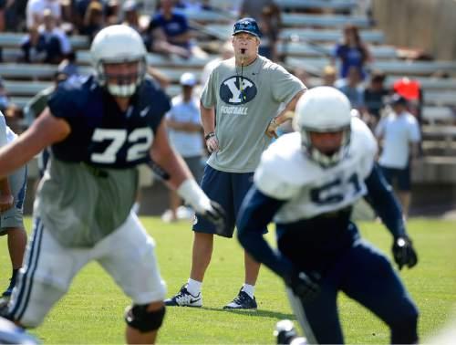 Scott Sommerdorf   |  The Salt Lake Tribune BYU head coach Bronco Mendenhall watches during practice, Saturday, August 22, 2015.